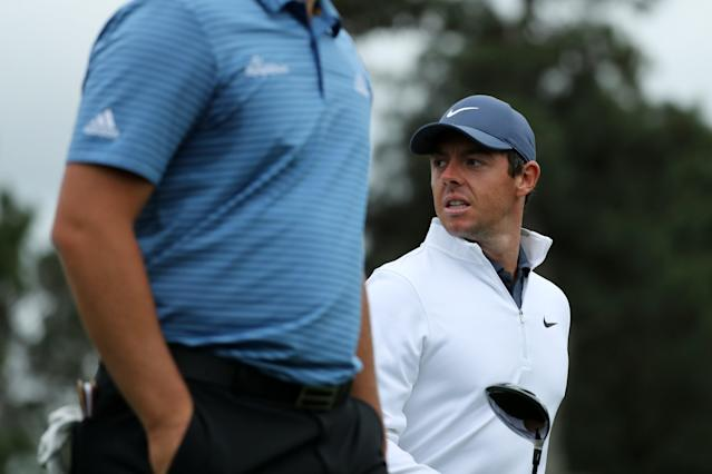 Rory McIlroy of Northern Ireland looks back past Jon Rahm of Spain during the final day of practice for the 2018 Masters golf tournament at Augusta National Golf Club in Augusta, Georgia, U.S. April 4, 2018. REUTERS/Lucy Nicholson