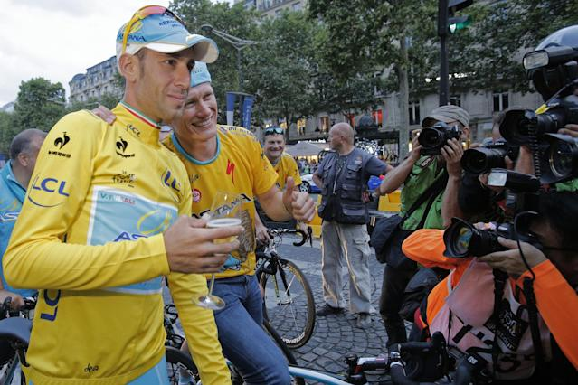 Astana team manager Alexander Vinokourov and 2014 Tour de France cycling race winner Italy's Vincenzo Nibali pose for photographers during the team parade of the Tour de France cycling race in Paris, France, Sunday, July 27, 2014. (AP Photo/Christophe Ena)