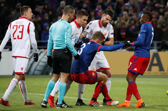 Soccer Football - Europa League Round of 32 Second Leg - CSKA Moscow vs Red Star Belgrade - VEB Arena, Moscow, Russia - February 21, 2018 CSKA Moscow's Pontus Wernbloom is helped up by Ahmed Musa REUTERS/Maxim Shemetov