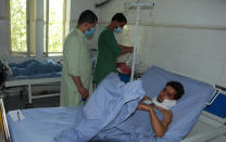 Afghan men are treated at a hospital after being injured in fighting between Taliban and Afghan security forces in Kunduz city, north of Kabul, Afghanistan, Thursday, June 24, 2021. Taliban gains in north Afghanistan, the traditional stronghold of the country's minority ethnic groups who drove the insurgent force from power nearly 20 years ago, has driven a worried government to resurrect militias whose histories have been characterized by chaos and widespread killing. (AP Photo/Samiullah Quraishi)