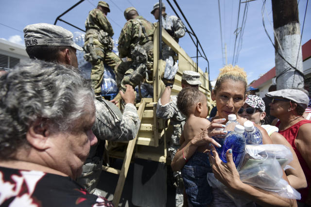 National Guard soldiers distribute water and food to residents of Puerto Rico, Sept. 24, 2017. (Photo: Carlos Giusti/AP)