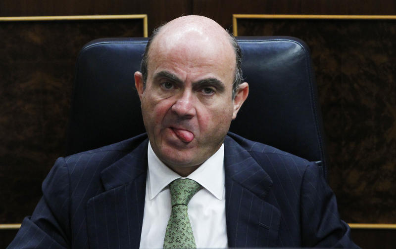 Spain's Economy Minister Luis De Guindos looks on during Spain's Prime Minister Mariano Rajoy's speech during a control session at the Spanish Parliament, in Madrid, Spain, Wednesday, July 11, 2012. Spain has announced a euro 65 billion austerity package that includes tax hikes and spending cuts a day after winning approval from euro zone partners for a huge bailout of Spain's banks. (AP Photo/Andres Kudacki)