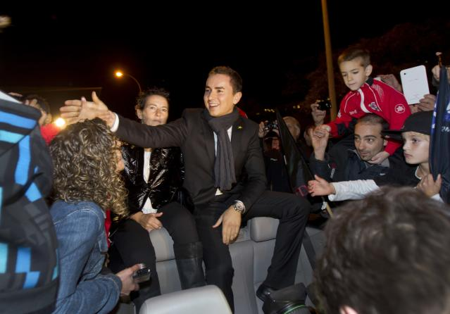 Moto GP world champion Spain's rider Jorge Lorenzo (C) meets his fans as he sits in a car in Palma de Mallorca during a parade on November 19, 2012. AFP PHOTO/ JAIME REINAJAIME REINA/AFP/Getty Images