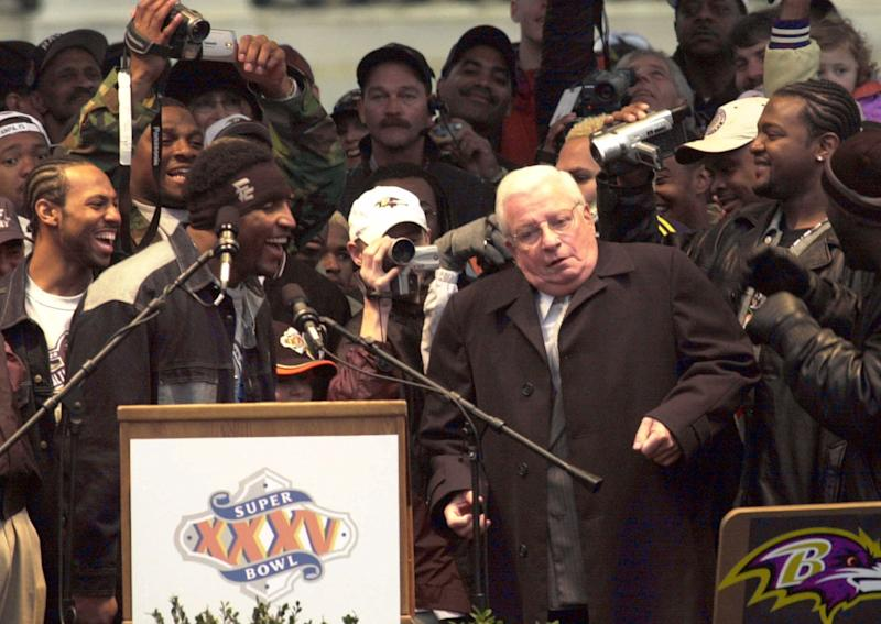 FILE - This Jan. 30, 2001 file photo shows Baltimore Ravens owner Art Modell, right, dancing with Super Bowl Most Valuable Player Ray Lewis, left foreground, as members of the team react during the celebration following the Ravens Super Bowl victory parade at City Hall in Baltimore. Former Ravens owner Modell has died. He was 87. The team said Modell died of natural causes early Thursday, Sept. 6, 2012, at Johns Hopkins Hospital, where he had been admitted Wednesday.(AP Photo/Chris Gardner, File)