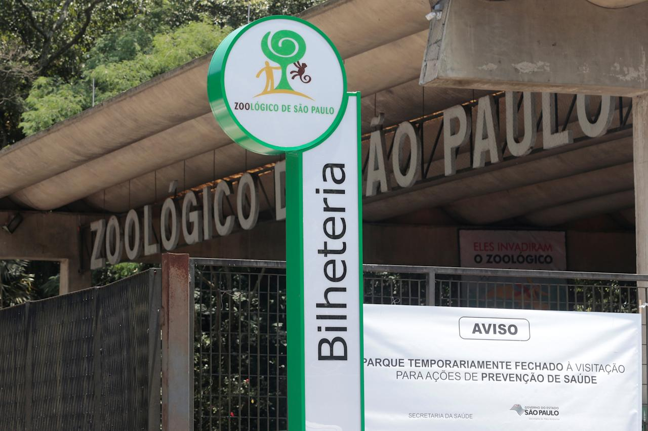 """The main entrance of Sao Paulo's Zoo is seen in Sao Paulo, Brazil January 23, 2018. The sign reads: """"Park temporarily closed for visitation for preventive health actions."""" REUTERS/Leonardo Benassatto NO RESALES. NO ARCHIVES"""