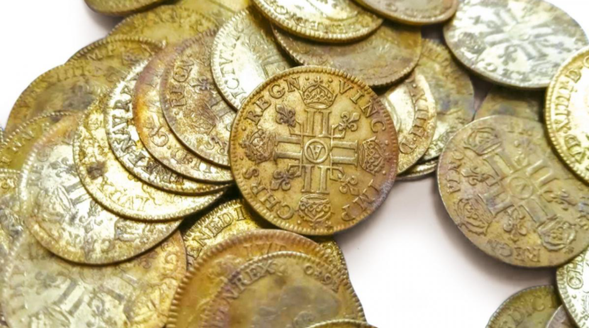 Close up of French coins dating back to 1638.
