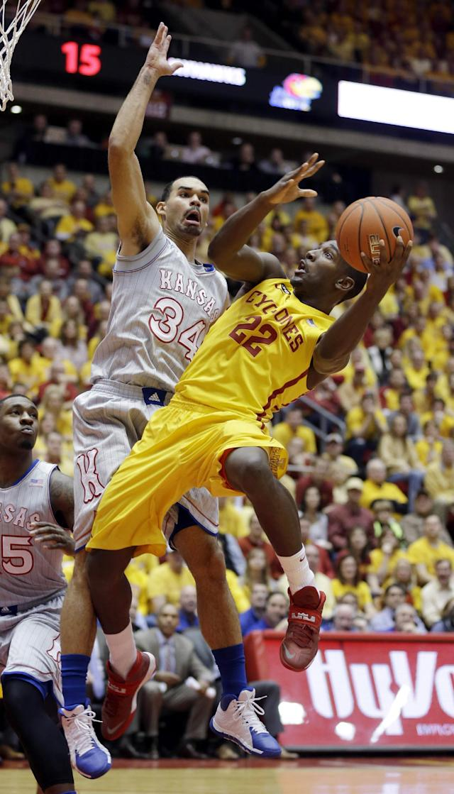 Iowa State forward Dustin Hogue, right, drives to the basket in front of Kansas forward Perry Ellis (34) during the first half of an NCAA college basketball game, Monday, Jan. 13, 2014, in Ames, Iowa. (AP Photo/Charlie Neibergall)