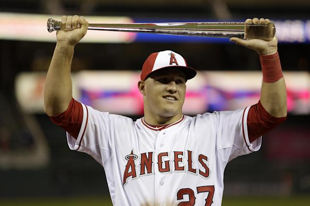 CORRECTS TO AMERICAN LEAGUE OUTFIELDER MIKE TROUT FROM AMERICAN LEAGUE PITCHER MIKE TROUT - American League outfielder Mike Trout, of the Los Angeles Angels, holds the MVP trophy after his team's 5-3 victory over the National League in the MLB All-Star baseball game, Tuesday, July 15, 2014, in Minneapolis. (AP Photo/Jeff Roberson)