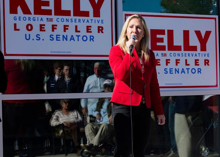 <p>Incoming congresswoman Marjorie Taylor Green, campaigning for Georgia Senator Kelly Loeffler in Georgia on 18 December, says she will reject electoral college votes for Joe Biden.</p> (AP)