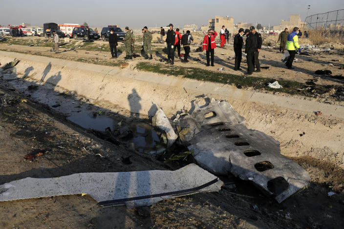 Debris is seen from an Ukrainian plane which crashed as authorities work at the scene in Shahedshahr southwest of the capital Tehran, Iran, Wednesday, Jan. 8, 2020.(Photo: Ebrahim Noroozi/AP)