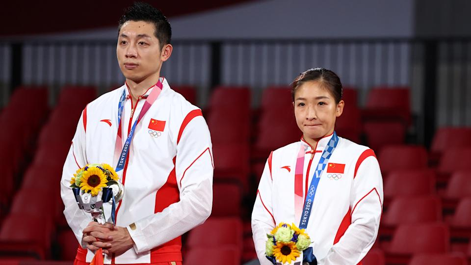 Tokyo 2020 Olympics - Table Tennis - Mixed Doubles - Medal Ceremony - Tokyo Metropolitan Gymnasium - Tokyo, Japan - July 26, 2021.  Silver medalists Xu Xin of China and Liu Shiwen of China during medal ceremony REUTERS/Thomas Peter