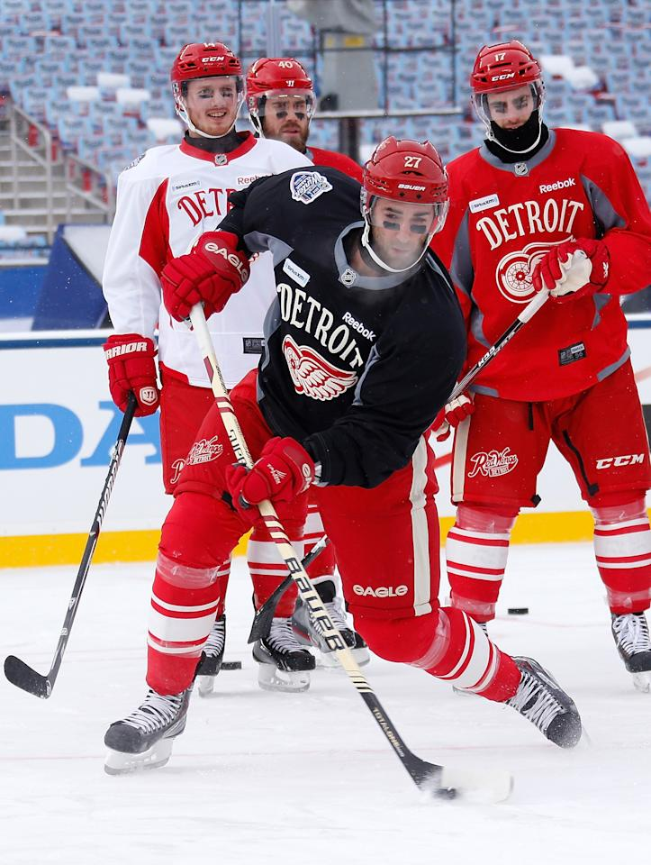 ANN ARBOR, MI - DECEMBER 31:(EDITORIAL USE ONLY) Kyle Quincey #27 of the Detroit Red Wings takes a shot during the team practice the day before the 2014 Bridgestone NHL Winter Classic at Michigan Stadium on December 31, 2013 in Ann Arbor, Michigan. (Photo by Gregory Shamus/Getty Images)