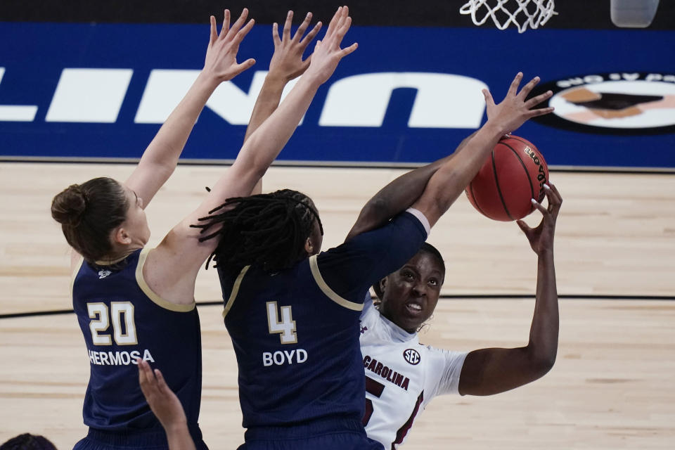 South Carolina forward Laeticia Amihere, right, shoots against Georgia Tech center Nerea Hermosa (20) and guard Anaya Boyd (4) during the first half of a college basketball game in the Sweet Sixteen round of the women's NCAA tournament at the Alamodome in San Antonio, Sunday, March 28, 2021. (AP Photo/Eric Gay)