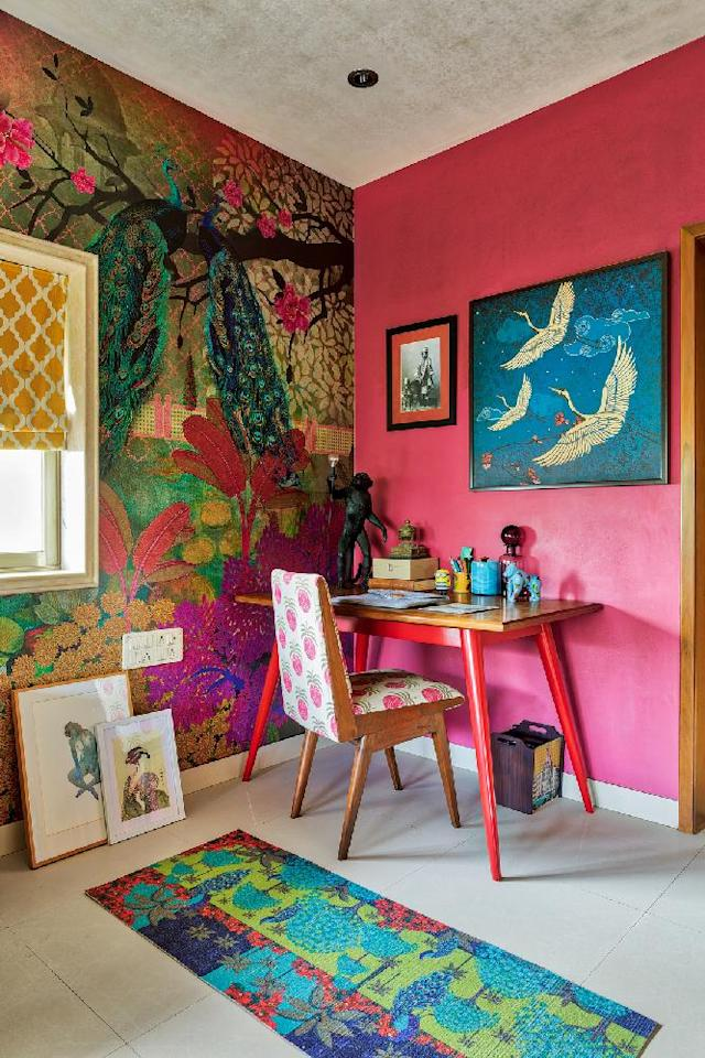 "At interior designer <a href=""https://fave.co/2Uighnp"">Krsnaa Mehta's apartment</a> in Breach Candy, Mumbai, the study is part of the master bedroom. While functional, its style reflects Mehta's trademark ethnic-chic aesthetic. Set against a bold pink wall, the nook is distinguished by patterns across varied media like wallpaper, soft furnishings and digital art prints. ""If playing with pattern, ensure one wall has pattern and the others are coordinated with single colours,"" says Mehta who is the founder of home decor and utilities brand <a href=""https://fave.co/39od5Lc"">India Circus</a>. The desk is tablescaped with pieces as varied as The Monkey Lamp by Italian brand Seletti and a Minions collectible."