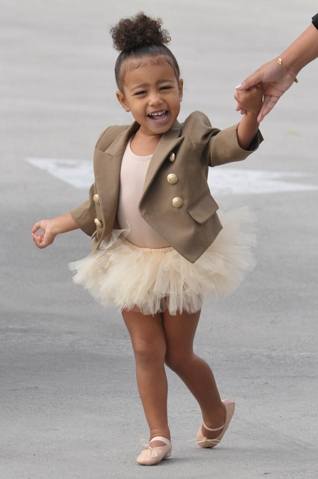<p>North makes the ballerina look the chicest, pairing her leotard and tutu with a baby Balmain jacket (is that one-of-a-kind?). (Photo: Splash) </p>