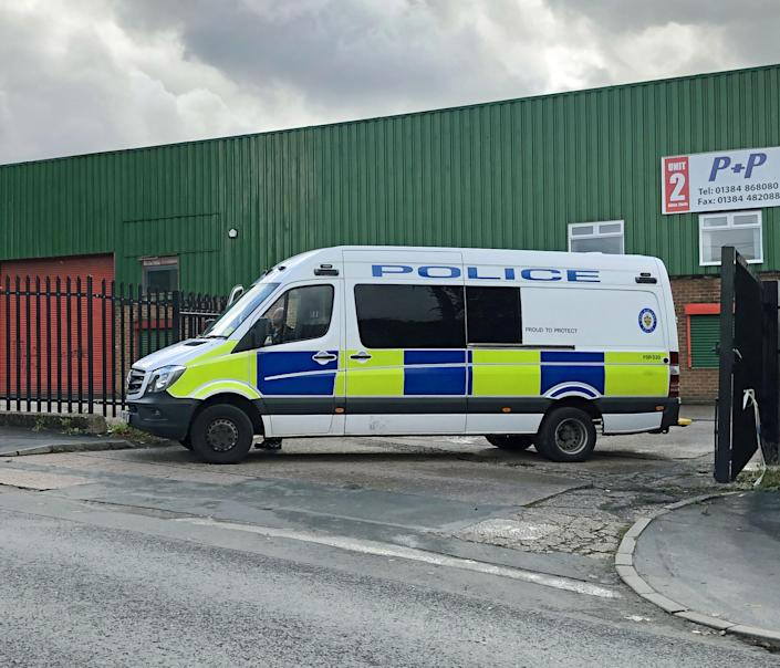 A police vehicle blocking an entrance to Albion Works industrial estate in Brierley Hill, West Midlands. (PA)