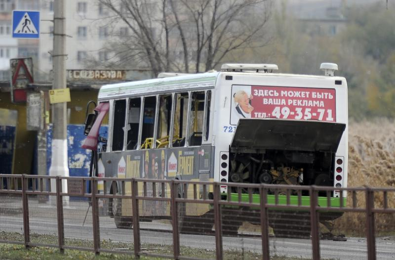 "A damaged bus is examined by experts in Volgograd, Monday, Oct. 21, 2013. The blast was caused by ""an unspecified explosive device,"" the National Anti-Terrorism Committee said in a statement. A total of 40 people were on the city bus at the time of the explosion, the Emergency Situations Ministry said. At least five died and some people were injured. (AP Photo/ Sergei Ivanishin)"