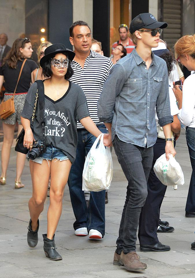 """Vanessa Hudgens showed off her unique sense of style (and quite a bit of leg!) while out and about in Venice, Italy, with beau Austin Butler on Wednesday afternoon. In addition to a pair of barely-there Daisy Dukes, the former """"High School Musical"""" hottie sported an equally absurd chapeau, over-sized """"Are You Afraid of the Dark"""" tee, hoof-like booties, and a bizarre mask. If Van was looking to go incognito for the day, she certainly went about it the wrong way. (9/5/2012)<br><br><a target=""""_blank"""" href=""""http://twitter.com/YahooOmg"""">Follow omg! on Twitter!</a>"""