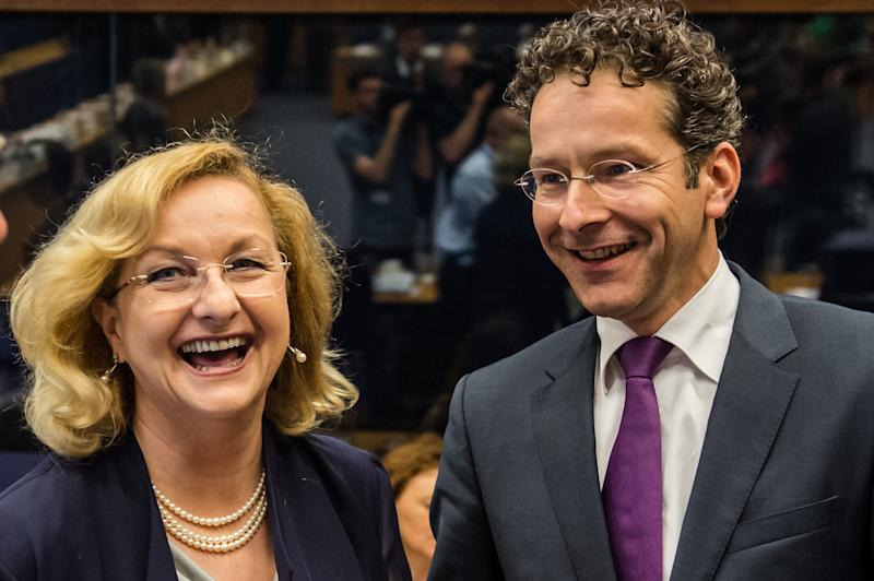 Austria's Finance Minister Maria Fekter, left, smiles as she talks with the President of the Eurogroup Jeroen Dijsselbloem during a Eurogroup meeting in Luxembourg, Thursday, June 20, 2013. (AP Photo/Geert Vanden Wijngaert)