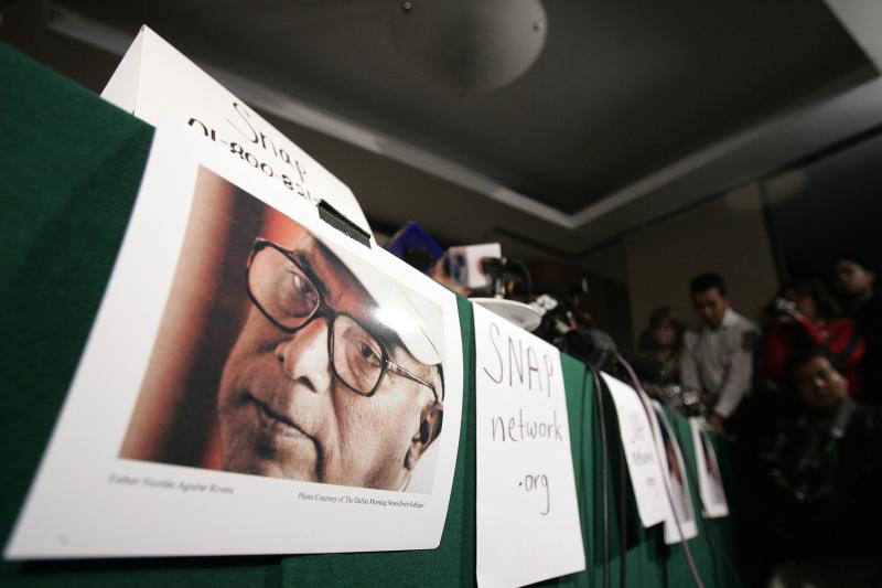 FILE - This Sept. 20, 2006 file photo shows a picture of priest Nicolas Aguilar during a news conference to announce a lawsuit against members of the Roman Catholic church in Mexico City. The Roman Catholic Archdiocese of Los Angeles will pay $13 million to settle 17 clergy abuse lawsuits, including 11 that involve Aguilar who fled prosecution and remains a fugitive more than 25 years later, plaintiffs' attorneys said Tuesday Feb. 18, 2014. (AP Photo/Gregory Bull,File)