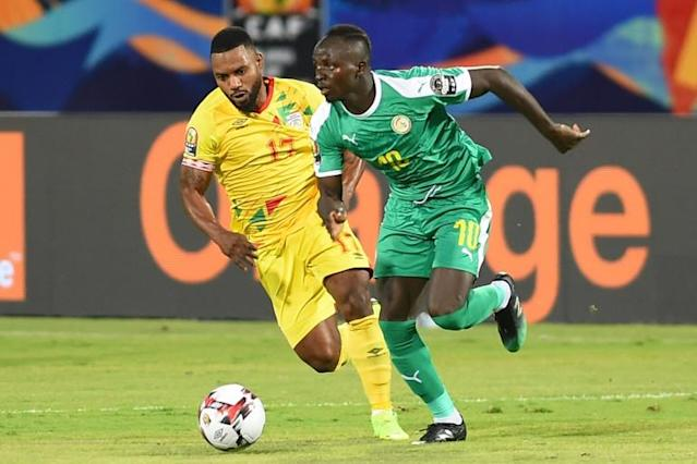 Senegal star Sadio Mane (R) makes a run during the Africa Cup of Nations quarter-final win over Benin in Cairo (AFP Photo/MOHAMED EL-SHAHED )