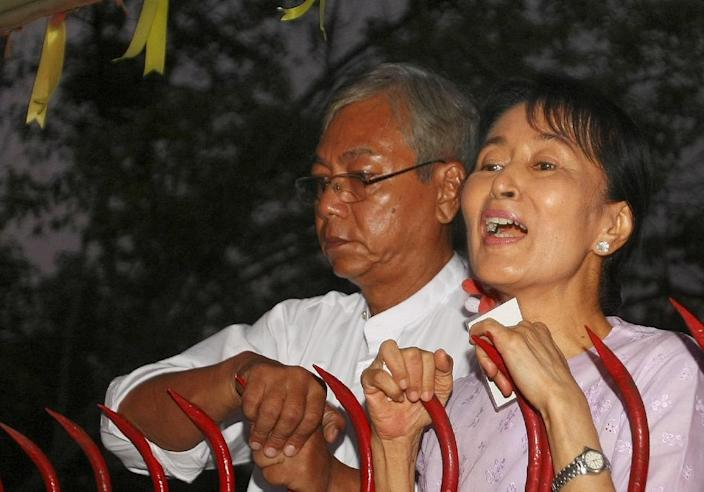 Myanmar's opposition leader Aung San Suu Kyi (R) appears with Htin Kyaw (L) a senior National League for Democracy (NLD) official, at the gate of her house after her release in Yangon on November 13, 2010 (AFP Photo/Soe Than Win)