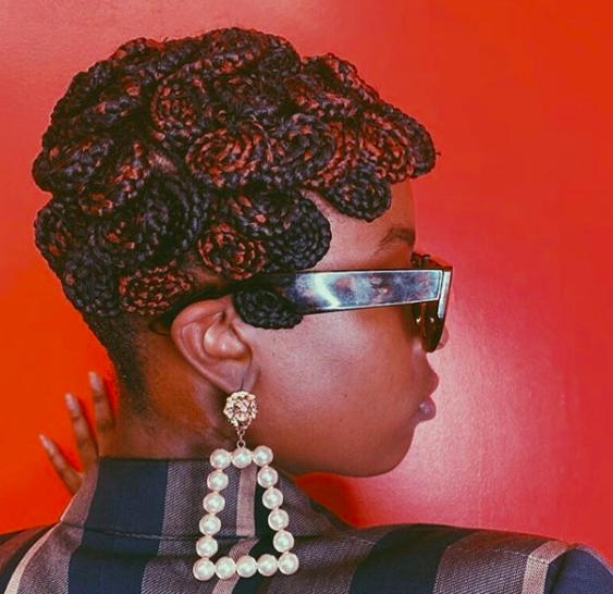 """This layered cornrow look by celebrity stylist <a href=""""https://www.hairbysusy.com/"""" rel=""""nofollow noopener"""" target=""""_blank"""" data-ylk=""""slk:Susy Oludele"""" class=""""link rapid-noclick-resp"""">Susy Oludele</a> is far from your standard straight-back cornrows. The curl pattern is both a fun and elegant way to switch up the protective style, and the red highlights add just the right amount of pop."""