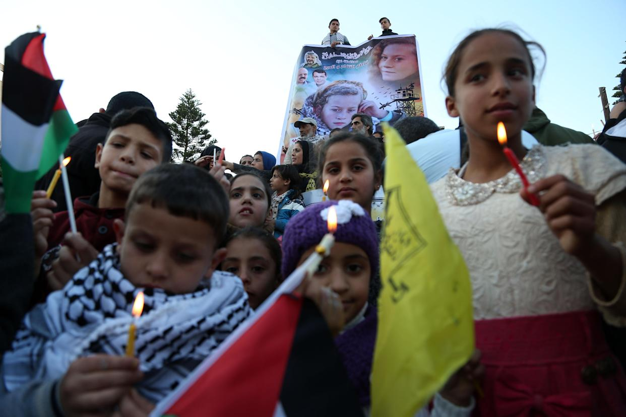 Palestinian children hold candles during a demonstration in support of Ahed Tamimi in Gaza City on Jan. 8, 2018 . (Photo: Majdi Fathi/NurPhoto via Getty Images)
