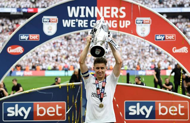 "Soccer Football - Championship Play-Off Final - Fulham vs Aston Villa - Wembley Stadium, London, Britain - May 26, 2018 Fulham's Tom Cairney celebrates promotion to the Premier League with the trophy Action Images via Reuters/Tony O'Brien EDITORIAL USE ONLY. No use with unauthorized audio, video, data, fixture lists, club/league logos or ""live"" services. Online in-match use limited to 75 images, no video emulation. No use in betting, games or single club/league/player publications. Please contact your account representative for further details."