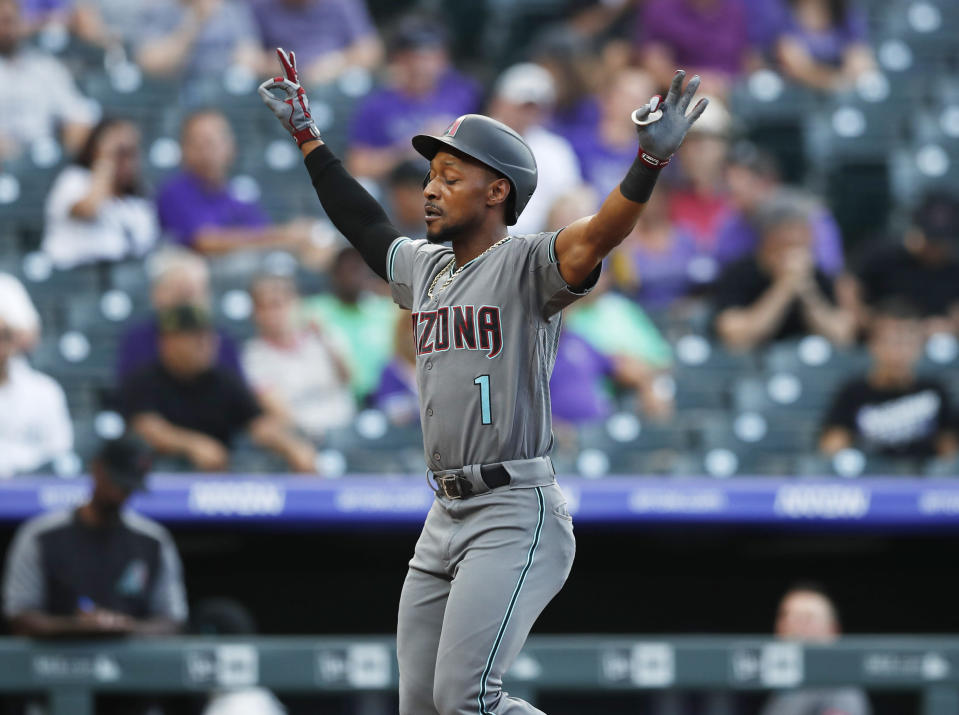 Arizona Diamondbacks' Jarrod Dyson gestures as he crosses home plate after hitting a solo home run off Colorado Rockies starting pitcher Jeff Hoffman to lead off the first inning of a baseball game Tuesday, Aug. 13, 2019, in Denver. (AP Photo/David Zalubowski)