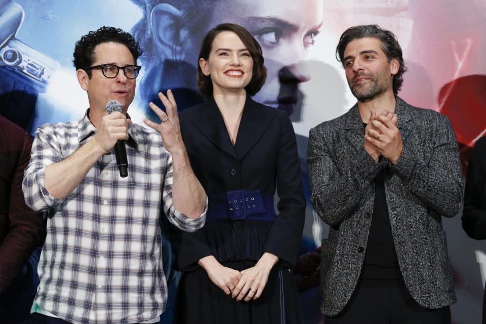 TOKYO, JAPAN - DECEMBER 12: (LR) J.J. Abrams, Daisy Ridley and Oscar Isaac attend the press conference for 'Star Wars: The Rise of Skywalker' at Toho Cinemas Roppongi on December 12, 2019 in Tokyo, Japan. (Photo by Yuichi Yamazaki/Getty Images)