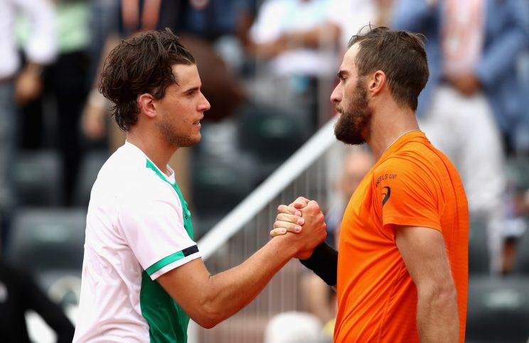 Dominic Thiem (left) and Steve Johnson Jr. (right) shake hands after Thiem swept Johnson in three sets in the third round of the French Open. (Getty Images)