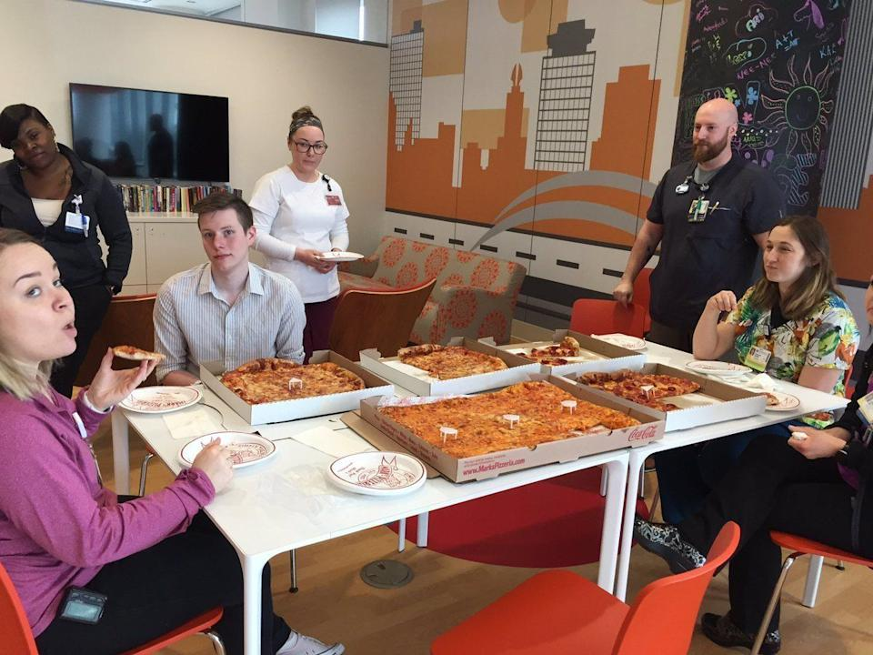 Cole Favro hosts a pizza party at the hospital with all the pizzas delivered to him over the Easter weekend. (Credit: Spectrum News Rochester Photographer Mike Moss)
