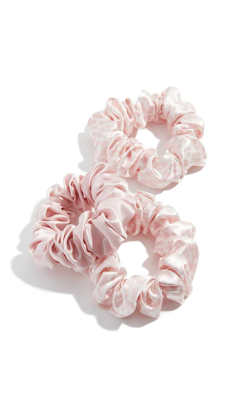 """<h3>Slip Silk Scrunchies</h3><br>If you're looking for pink silk — specifically the kind featured in the shot above — check out this set by Slip.<br><br><strong>Slip</strong> Classic Large Scrunchie Set of 3, $, available at <a href=""""https://go.skimresources.com/?id=30283X879131&url=https%3A%2F%2Fwww.shopbop.com%2Fclassic-large-scrunchie-set-slip%2Fvp%2Fv%3D1%2F1580971710.htm%3Ffm%3Dsearch-viewall%26os%3Dfalse"""" rel=""""nofollow noopener"""" target=""""_blank"""" data-ylk=""""slk:Shopbop"""" class=""""link rapid-noclick-resp"""">Shopbop</a>"""