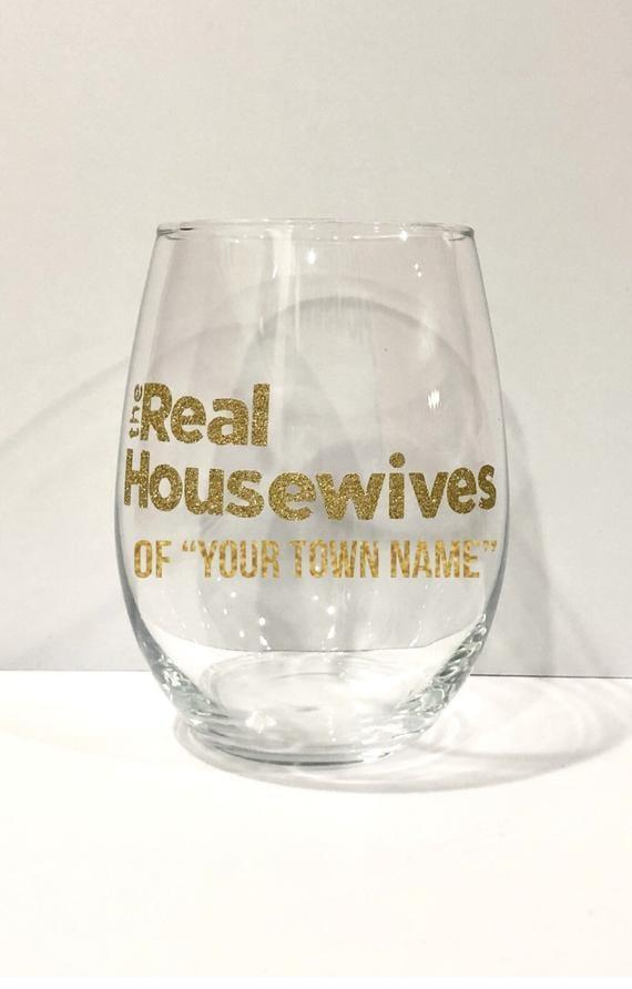 """<p>The <span>The Real Housewives of """"Your Hometown"""" Wine Glass</span> ($11-$13) let's you and your loved ones vicariously live out your Housewives dream.</p>"""