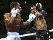 Devin Haney, left, punches Jorge Linares during the WBC lightweight title boxing match Saturday, May 29, 2021, in Las Vegas. (AP Photo/Chase Stevens)