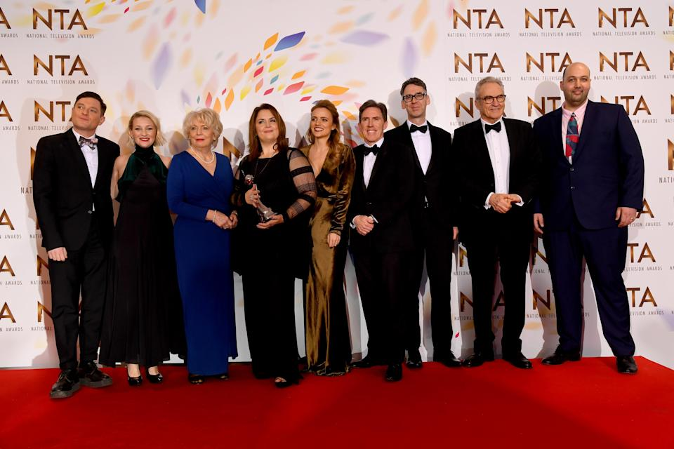 """Mathew Horne, Joanna Page, Alison Steadman, Ruth Jones, Laura Aikman, Rob Brydon, Robert Wilfort, Larry Lamb and guest, accepting the Impact Award for """"Gavin and Stacey, Christmas Special"""", pose at the National Television Awards 2020 at The O2 Arena on January 28, 2020 in London, England. (Photo by Dave J Hogan/Getty Images)"""