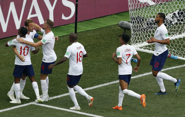 <p>England's Harry Kane, left, celebrates with his teammates after scoring his second penalty </p>