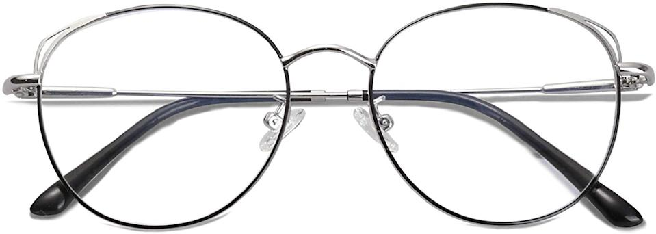 """<h2>SOJOS Blue Light Blocking Glasses</h2><br>Our VP of partnership management received so many compliments on these blue-light blocking glasses that she was <a href=""""https://www.refinery29.com/en-us/amazon-blue-light-blocking-glasses"""" rel=""""nofollow noopener"""" target=""""_blank"""" data-ylk=""""slk:compelled to share the good news with our readers"""" class=""""link rapid-noclick-resp"""">compelled to share the good news with our readers</a>, propelling these throwback frames to one of the top-selling spots in 2020. While there's no hard science behind the effectiveness of these lenses, she felt the difference right away. """"Not feeling tired at the end of the workday and a noticeable lack of headaches are a way better payoff than the consistent compliments the frames generate,"""" she wrote. """"I highly recommend trying these babies out. 'Wellness' comes in all forms, whether it's reduced eye strain brought on by super-power lenses or the simple self-esteem boost of wearing a cool and super-flattering new pair of specs.<br><br><strong>4.4 out of 5 stars and 6,650 reviews</strong><br><br><strong>Sojos</strong> Blue Light Blocking Glasses, $, available at <a href=""""https://amzn.to/36x8vKc"""" rel=""""nofollow noopener"""" target=""""_blank"""" data-ylk=""""slk:Amazon"""" class=""""link rapid-noclick-resp"""">Amazon</a>"""