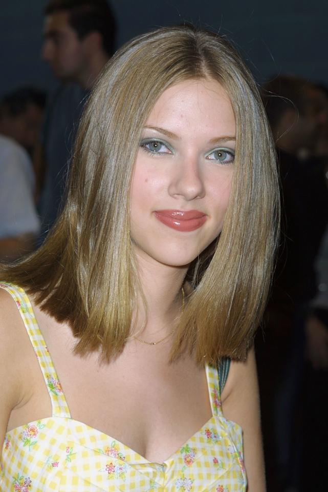 <p>Wearing her shoulder-length blonde hair in a sleek straight style, Johansson looked like an elegant young star at the <em>Lisa Picard Is Famous</em> film premiere in 2001.</p>