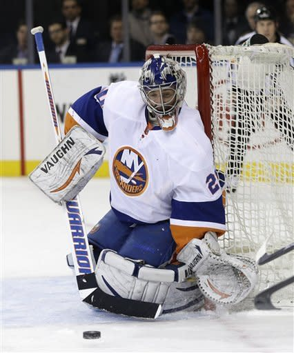 New York Islanders goalie Evgeni Nabokov defends the net during the second period of the NHL hockey game against the New York Rangers in New York, Thursday, Feb. 7, 2013. (AP Photo/Seth Wenig)