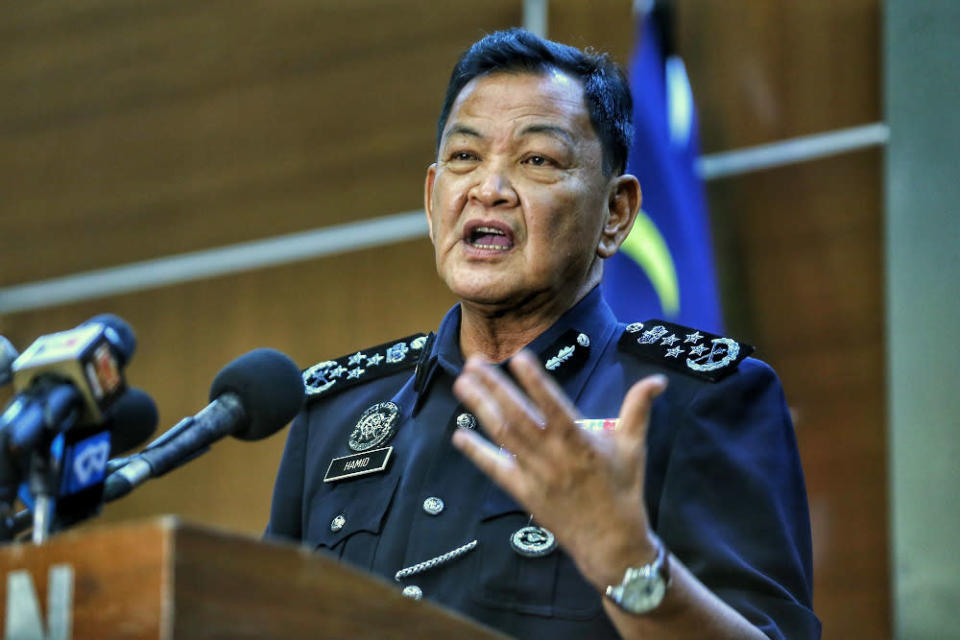 Outgoing Inspector-General of Police Tan Sri Abdul Hamid Bador speaks at his last press conference in Bukit Aman, April 30, 2021. — Picture by Ahmad Zamzahuri