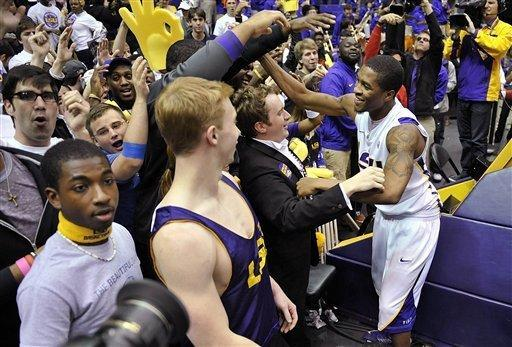 LSU guard Malik Morgan, right, celebrates with students after their 73-70 win over Missouri in an NCAA college basketball game at the Pete Maravich Assembly Center in Baton Rouge, La., Wednesday, Jan. 30, 2013. (AP Photo/Bill Feig)