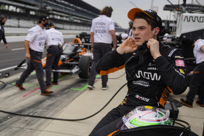 Pato O'Ward of Mexico removes his ear plugs following a practice session for the Indianapolis 500 auto race at Indianapolis Motor Speedway in Indianapolis, Tuesday, May 18, 2021. (AP Photo/Michael Conroy)