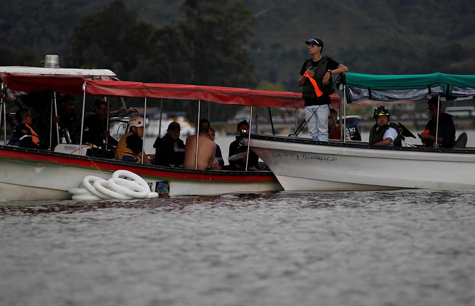<p>Rescuers search for victims after a tourist boat sank with 150 passengers in the Guatape reservoir, Colombia, June 25, 2017. (Fredy Builes/Reuters) </p>