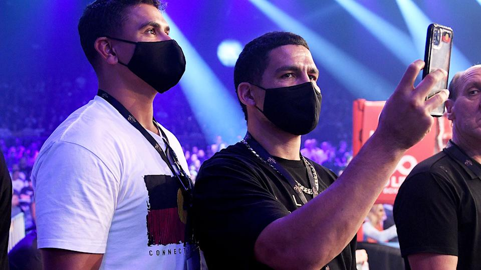 Latrell Mitchell and Cody Walker, pictured here at Tim Tszyu's fight with Dennis Hogan.