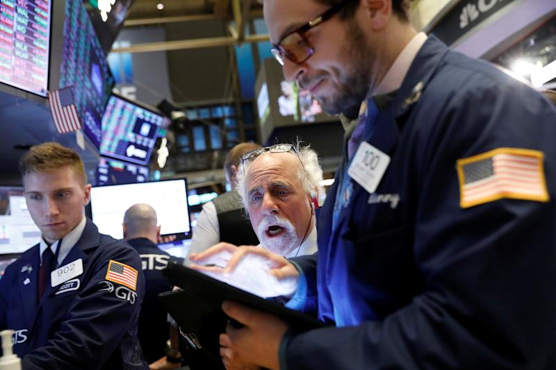 Traders work on the floor at the New York Stock Exchange (NYSE) in New York, U.S., January 14, 2020. REUTERS/Brendan McDermid