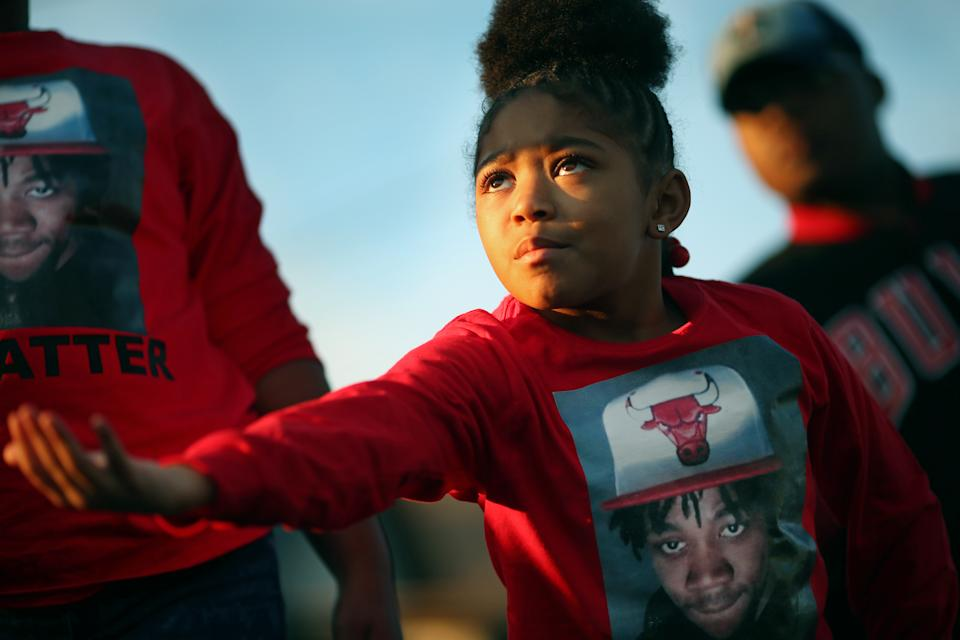 A niece of Jamar Clark gestures at a memorial for her uncle, Jamar Clark, who was killed in a confrontation with city police last fall to commemorate his death Tuesday October 15, 2016 in Minneapolis, MN. (Jerry Holt/Star Tribune via Getty Images)