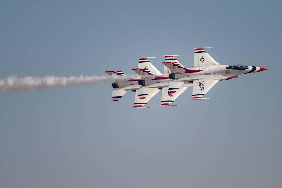 """Three F-16 Fighting Falcon jets with the U.S. Air Force Air Demonstration Squadron """"Thunderbirds"""" perform an echelon pass at the California Capital Airshow on Friday, Sept. 24, 2021, at Mather Airport in Sacramento."""