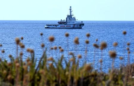 Spanish migrant rescue ship Open Arms lies anchored close to the Italian shore in Lampedusa